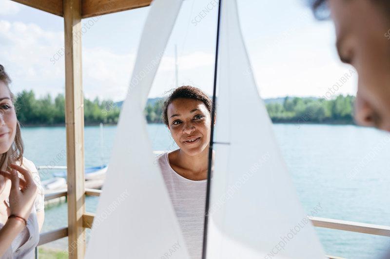 Man talking through sailing boat parts