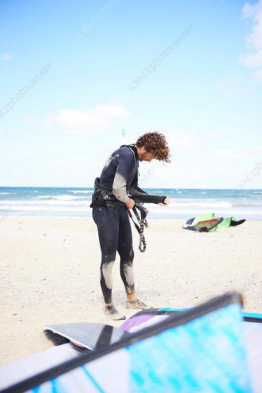 Kite surfer making preparations on beach, Denmark