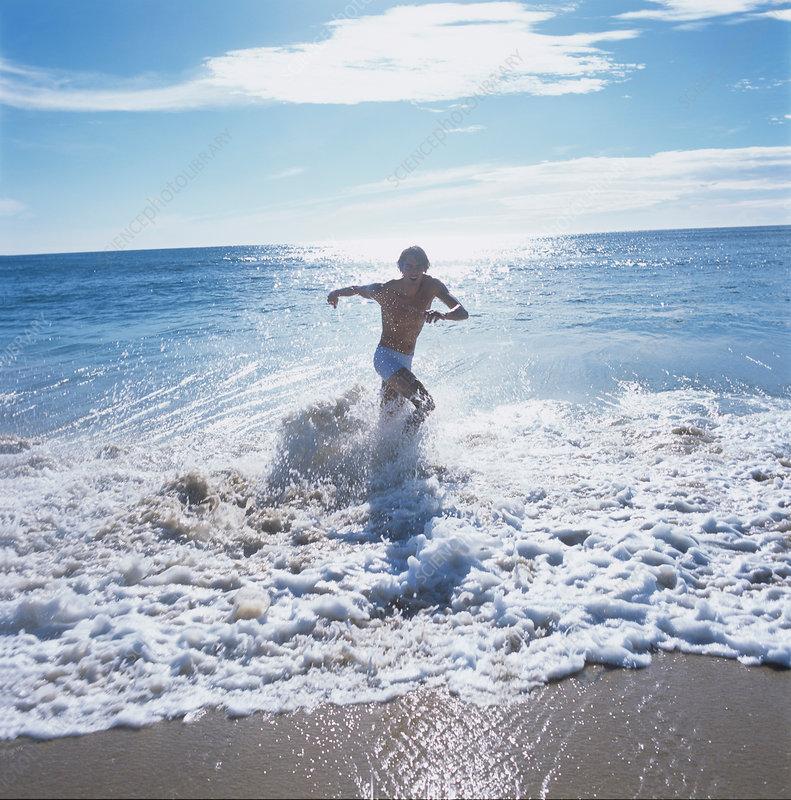 Man splashing in sea, China Bay, Sri Lanka