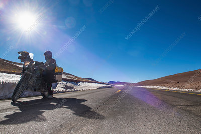 Woman beside motorbike, Antofagasta, Chile