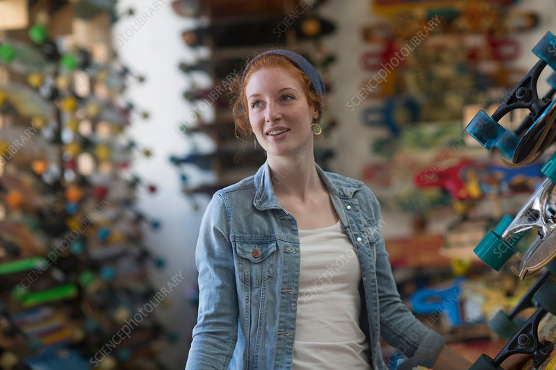 Portrait of woman in skateboard shop