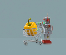 Toy robot pushing miniature shopping trolley