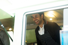 Business owner serving customer at food truck hatch