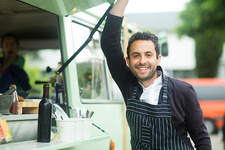 Business owner opening food truck hatch