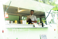 Small business owner preparing food in food truck