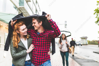Couple walking outdoors in rain