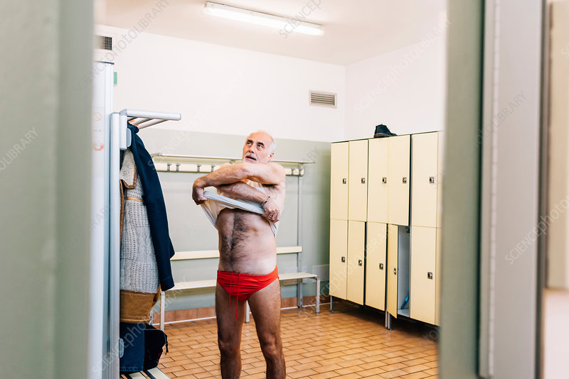 Senior man in locker room of swimming pool