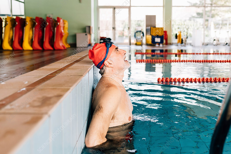 Senior man catching his breath in swimming pool