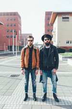 Portrait of two male hipster friends, full length