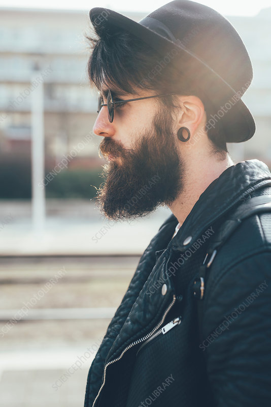 Young male hipster in sunglasses and trilby