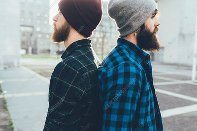 Portrait of two male hipsters in knit hats