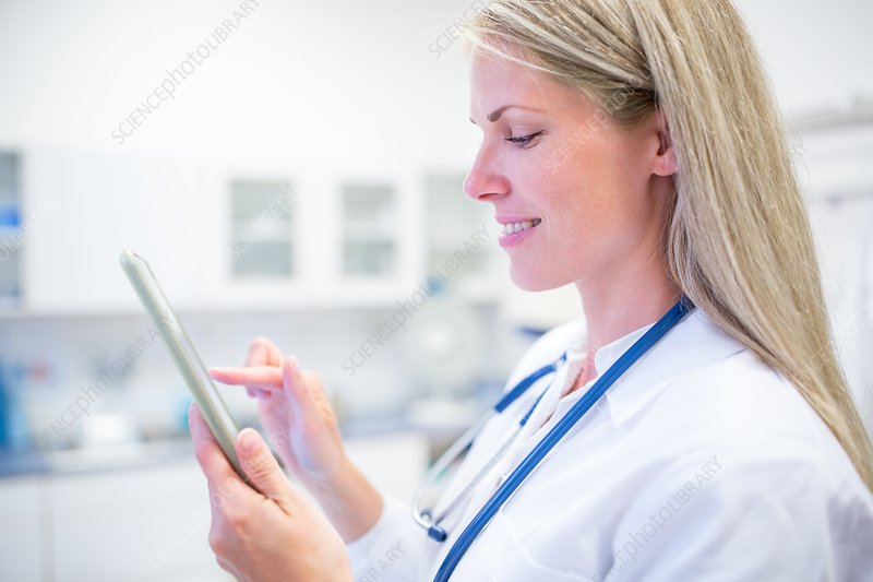 Portrait of doctor using digital tablet