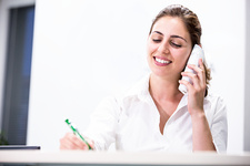 Medical receptionist on the telephone