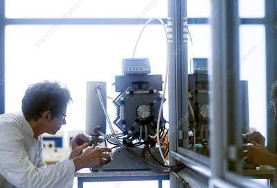 Chemist working with vacuum pump
