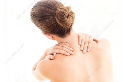 Woman touching her back