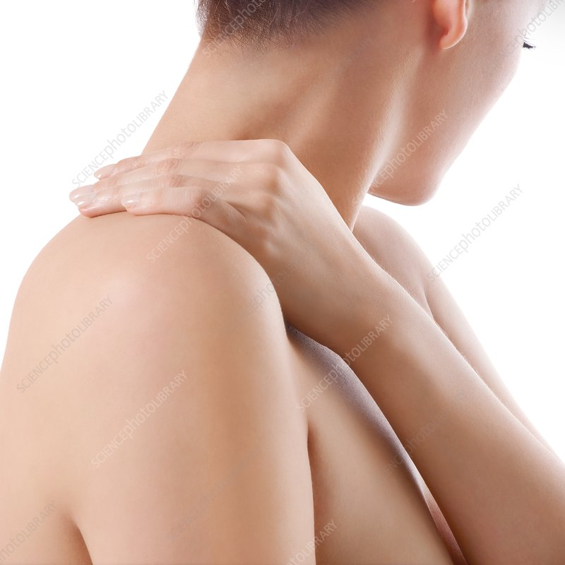 Woman rubbing her shoulder
