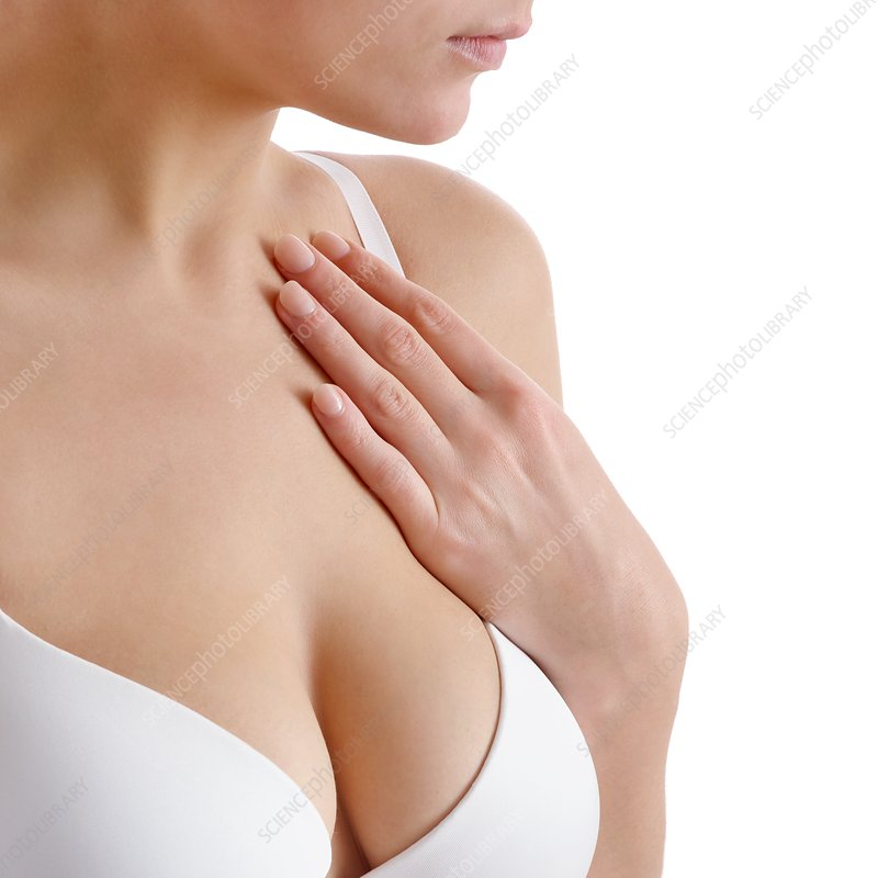 Woman touching her chest