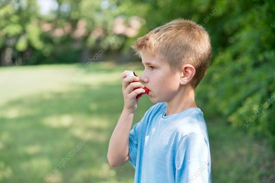 Young boy using an inhaler