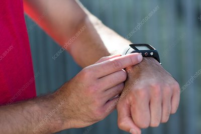 Male athlete checking sports watch