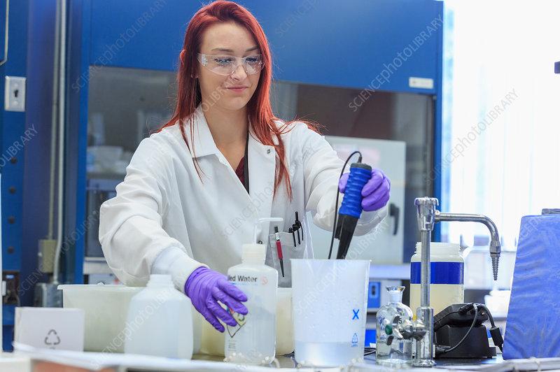 Chemist measuring pH