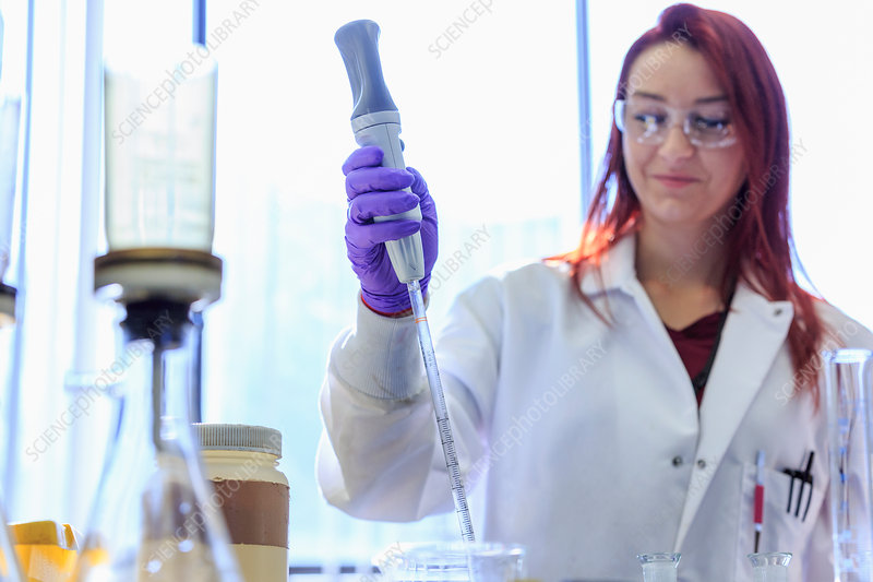 Chemist using pipette