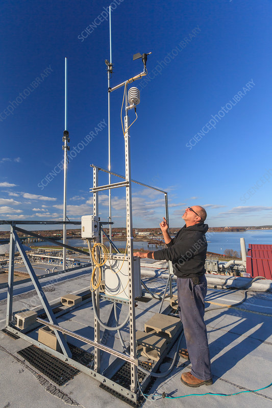 Engineer with weather sensors