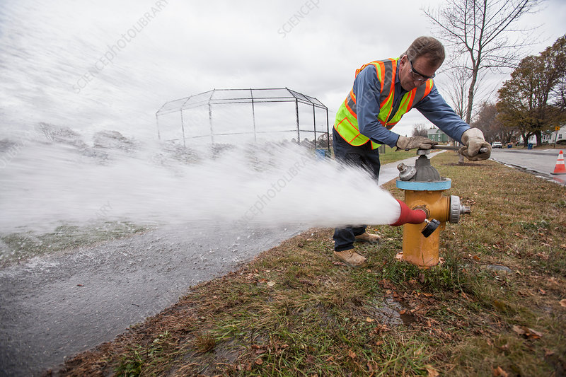 Opening fire hydrant to flush water pipes