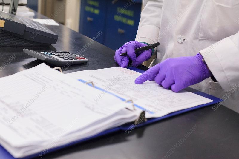 Lab technician recording data