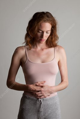 Young woman holding her stomach