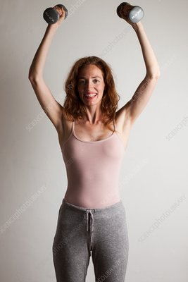 Happy woman doing strength exercise