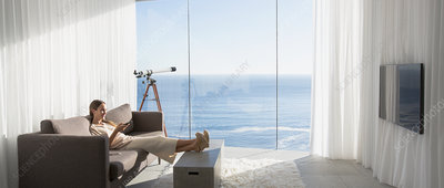 Woman relaxing with feet up, watching TV