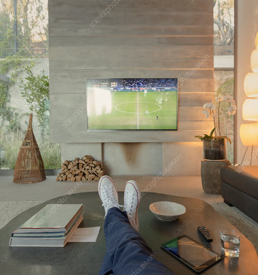 Woman watching soccer on TV