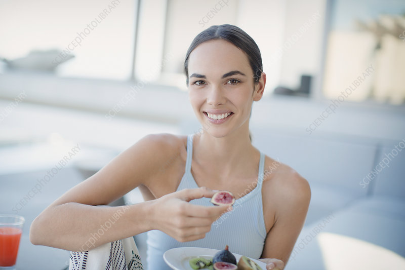 Woman eating figs