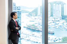 Businessman looking out of window at view of harbour
