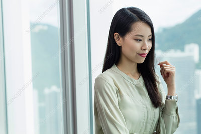 Portrait of businesswoman looking away smiling