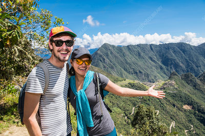 Couple posing for camera on the Inca Trail, Cusco, Peru