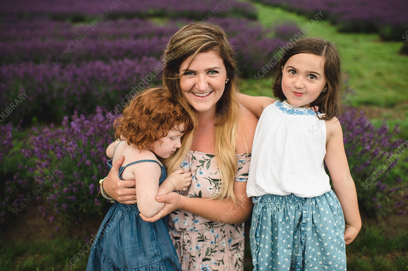 Mother and daughters in lavender field, Canada