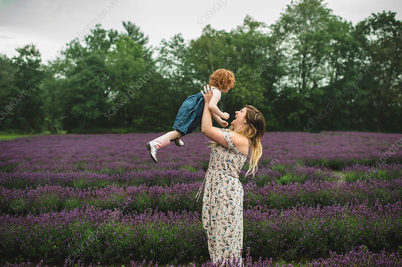 Mother and daughter in lavender field, Canada