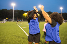 Female football players jubilant, Hackney, East London, UK