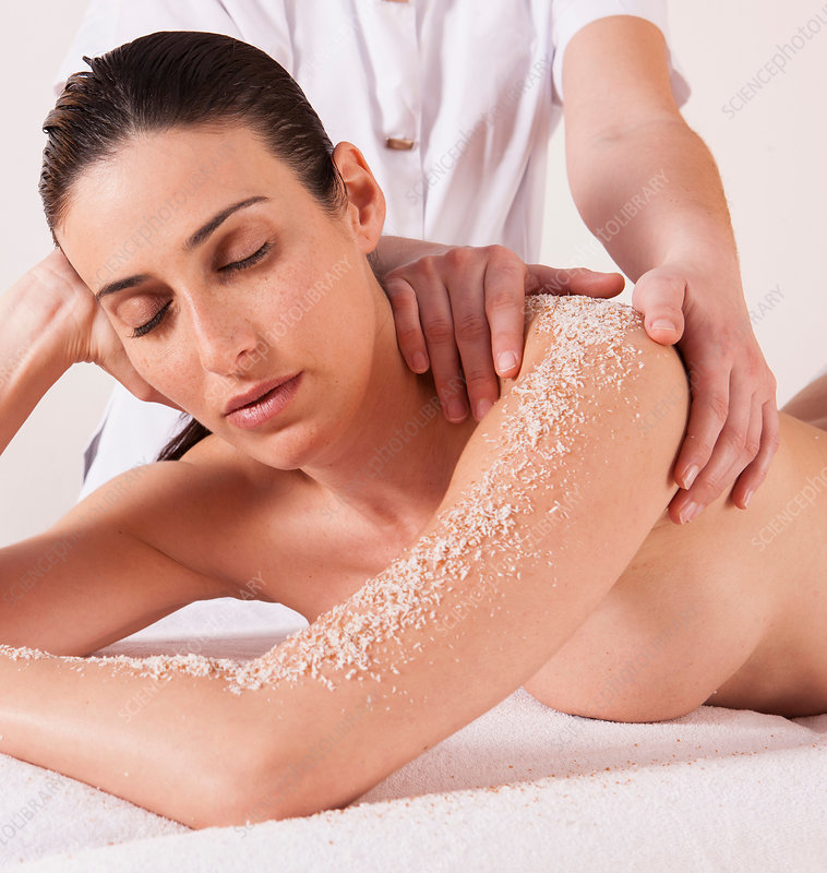 Woman in spa environment, having salt crystal massage