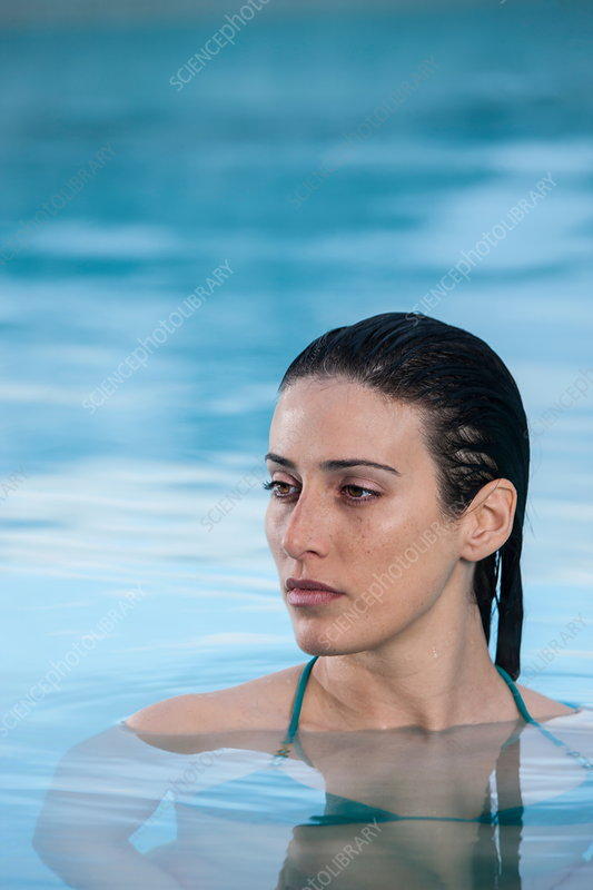 Woman relaxing in thermal pool
