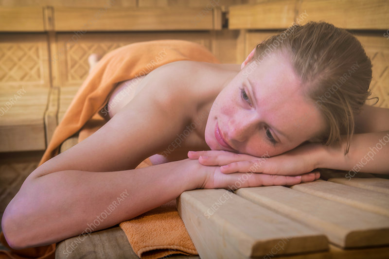 Woman relaxing in steam room