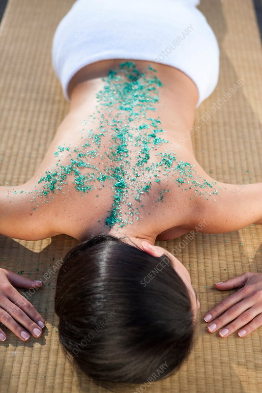 Woman relaxing with salt crystals on her back