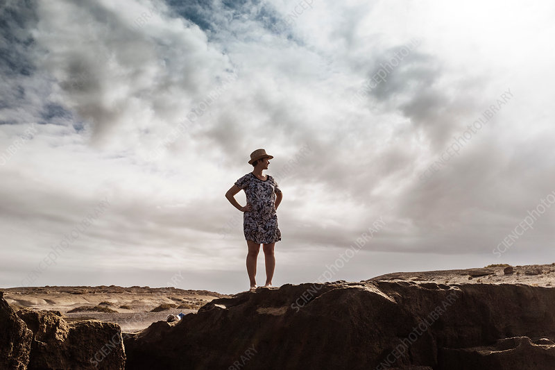 Woman standing on rocks, Canary Islands, Spain
