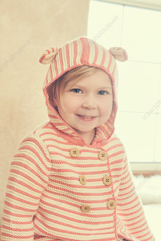 Portrait of female toddler in striped hood with ears