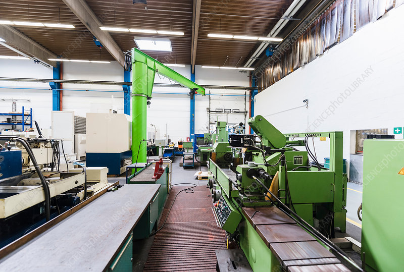 Factory interior, with machinery in foreground