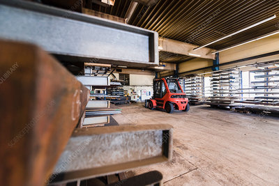 Factory interior with forklift truck