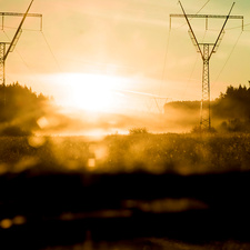 Electrical pylons against sunset
