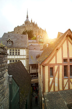 View of timber framed houses and Mont Saint-Michel, France