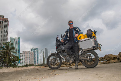 Man posing next to his motorbike, Colombia